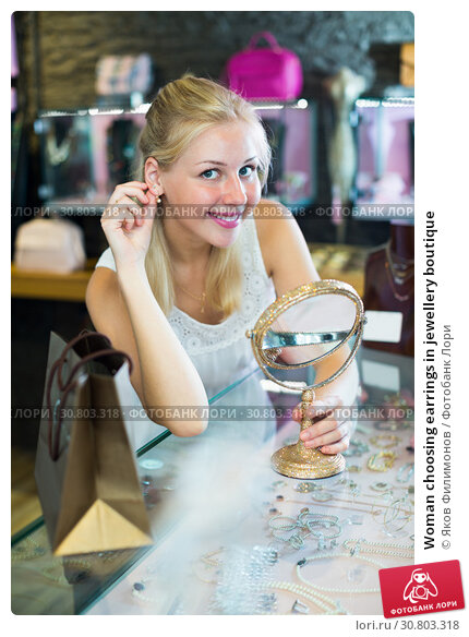 Купить «Woman choosing earrings in jewellery boutique», фото № 30803318, снято 16 июня 2019 г. (c) Яков Филимонов / Фотобанк Лори