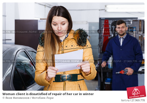 Купить «Woman client is dissatisfied of repair of her car in winter», фото № 27969778, снято 18 декабря 2017 г. (c) Яков Филимонов / Фотобанк Лори