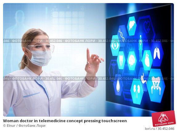 Woman doctor in telemedicine concept pressing touchscreen. Стоковое фото, фотограф Elnur / Фотобанк Лори