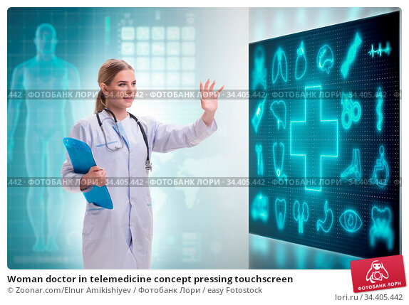 Woman doctor in telemedicine concept pressing touchscreen. Стоковое фото, фотограф Zoonar.com/Elnur Amikishiyev / easy Fotostock / Фотобанк Лори