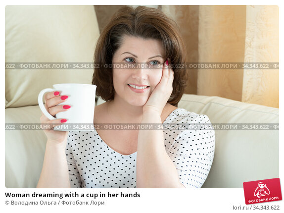 Woman dreaming with a cup in her hands. Стоковое фото, фотограф Володина Ольга / Фотобанк Лори