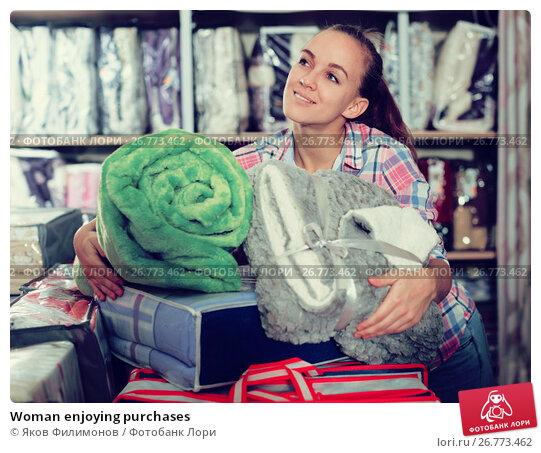 Купить «Woman enjoying purchases», фото № 26773462, снято 22 ноября 2017 г. (c) Яков Филимонов / Фотобанк Лори