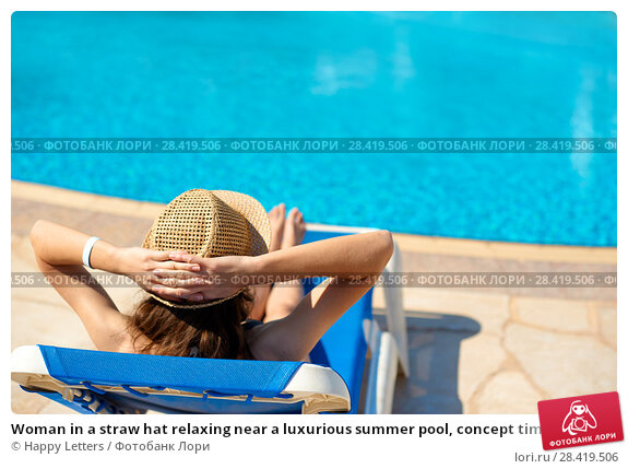 Купить «Woman in a straw hat relaxing near a luxurious summer pool, concept time to travel with space for your text», фото № 28419506, снято 16 апреля 2018 г. (c) Happy Letters / Фотобанк Лори