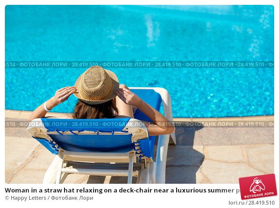 Купить «Woman in a straw hat relaxing on a deck-chair near a luxurious summer pool, concept time to travel», фото № 28419510, снято 16 апреля 2018 г. (c) Happy Letters / Фотобанк Лори