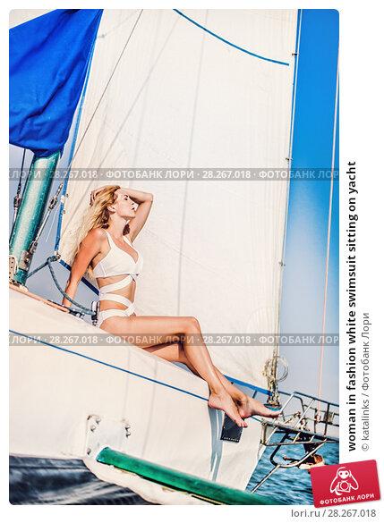 Купить «woman in fashion white swimsuit sitting on yacht», фото № 28267018, снято 25 июля 2017 г. (c) katalinks / Фотобанк Лори