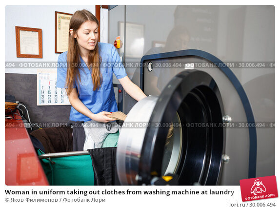 Купить «Woman in uniform taking out clothes from washing machine at laundry», фото № 30006494, снято 22 января 2019 г. (c) Яков Филимонов / Фотобанк Лори