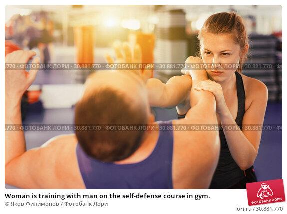 Купить «Woman is training with man on the self-defense course in gym.», фото № 30881770, снято 21 августа 2017 г. (c) Яков Филимонов / Фотобанк Лори