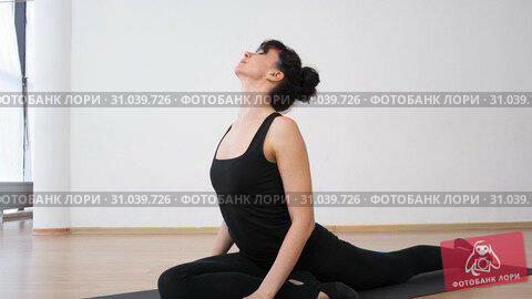Купить «Woman leans down and does bends in half -twine doing her pilates training», видеоролик № 31039726, снято 1 августа 2020 г. (c) Denis Mishchenko / Фотобанк Лори