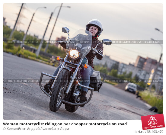 Купить «Woman motorcyclist riding on her chopper motorcycle on road», фото № 33403470, снято 14 июня 2017 г. (c) Кекяляйнен Андрей / Фотобанк Лори