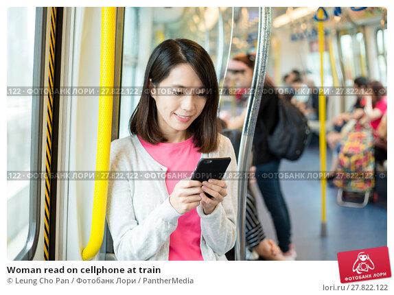 Купить «Woman read on cellphone at train», фото № 27822122, снято 26 февраля 2018 г. (c) PantherMedia / Фотобанк Лори