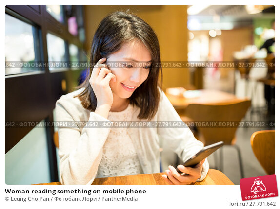 Купить «Woman reading something on mobile phone», фото № 27791642, снято 22 февраля 2018 г. (c) PantherMedia / Фотобанк Лори