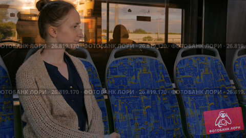 Купить «Woman relaxing and looking out of tram window.», видеоролик № 26819170, снято 8 августа 2017 г. (c) Aleksey Popov / Фотобанк Лори