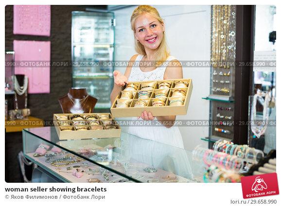 Купить «woman seller showing bracelets», фото № 29658990, снято 18 февраля 2019 г. (c) Яков Филимонов / Фотобанк Лори