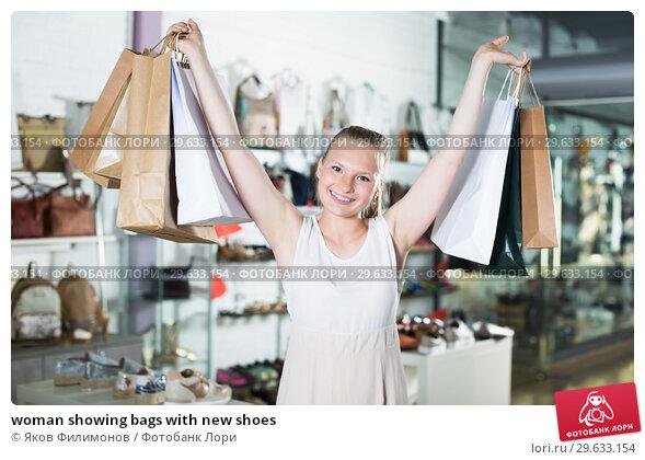 Купить «woman showing bags with new shoes», фото № 29633154, снято 27 мая 2017 г. (c) Яков Филимонов / Фотобанк Лори