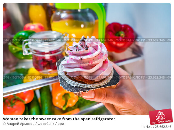 Купить «Woman takes the sweet cake from the open refrigerator», фото № 23662346, снято 29 сентября 2016 г. (c) Андрей Армягов / Фотобанк Лори