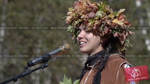 Woman talking about herself in Itelmen language, translates into Russian during women contest. Itelmens national ritual festival thanksgiving nature Alhalalalay. Kamchatka Peninsula (2019 год). Редакционное видео, видеограф А. А. Пирагис / Фотобанк Лори