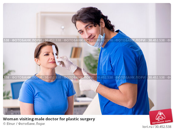 Woman visiting male doctor for plastic surgery. Стоковое фото, фотограф Elnur / Фотобанк Лори