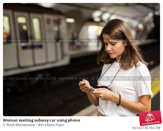 Woman waiting subway car using phone. Стоковое фото, фотограф Яков Филимонов / Фотобанк Лори