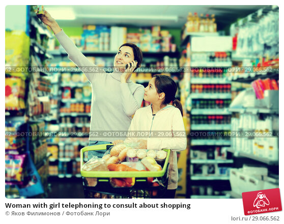 Купить «Woman with girl telephoning to consult about shopping», фото № 29066562, снято 5 января 2017 г. (c) Яков Филимонов / Фотобанк Лори
