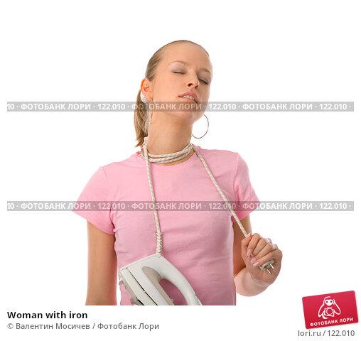 Купить «Woman with iron», фото № 122010, снято 1 апреля 2007 г. (c) Валентин Мосичев / Фотобанк Лори