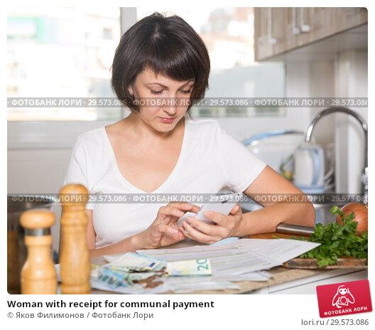Купить «Woman with receipt for communal payment», фото № 29573086, снято 22 ноября 2018 г. (c) Яков Филимонов / Фотобанк Лори
