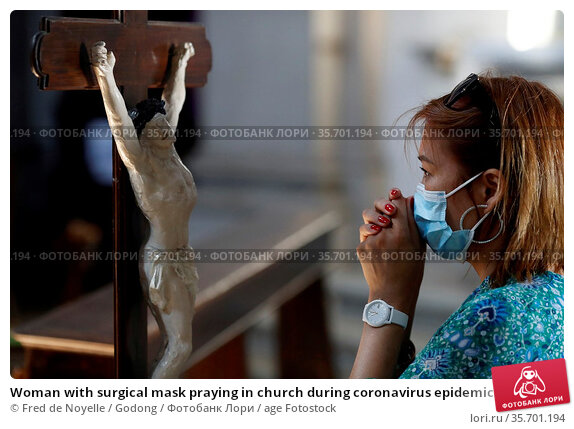 Woman with surgical mask praying in church during coronavirus epidemic... Стоковое фото, фотограф Fred de Noyelle / Godong / age Fotostock / Фотобанк Лори