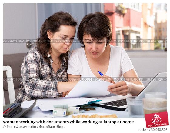 Купить «Women working with documents while working at laptop at home», фото № 30968526, снято 21 июля 2019 г. (c) Яков Филимонов / Фотобанк Лори