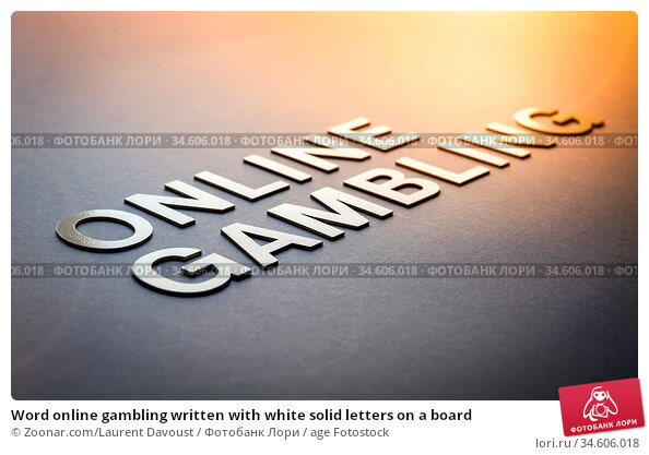Word online gambling written with white solid letters on a board. Стоковое фото, фотограф Zoonar.com/Laurent Davoust / age Fotostock / Фотобанк Лори