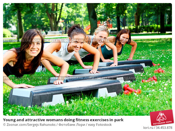 Young and attractive womans doing fitness exercises in park. Стоковое фото, фотограф Zoonar.com/Sergejs Rahunoks / easy Fotostock / Фотобанк Лори
