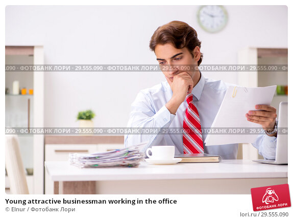 Купить «Young attractive businessman working in the office», фото № 29555090, снято 13 августа 2018 г. (c) Elnur / Фотобанк Лори