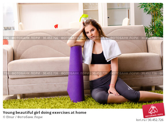 Young beautiful girl doing exercises at home. Стоковое фото, фотограф Elnur / Фотобанк Лори