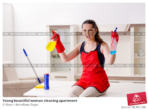 Young beautiful woman cleaning apartment. Стоковое фото, фотограф Elnur / Фотобанк Лори