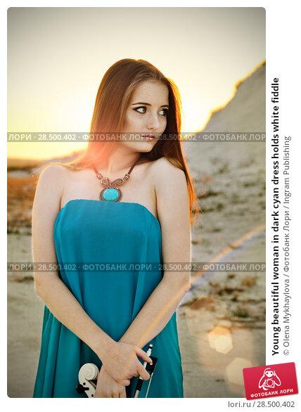 Купить «Young beautiful woman in dark cyan dress holds white fiddle», фото № 28500402, снято 30 июля 2013 г. (c) Ingram Publishing / Фотобанк Лори