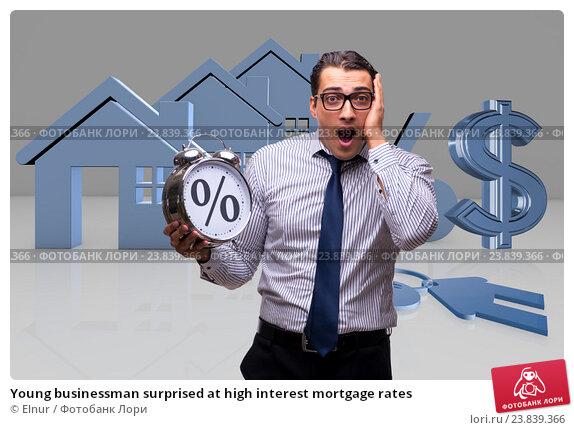 Купить «Young businessman surprised at high interest mortgage rates», фото № 23839366, снято 6 декабря 2019 г. (c) Elnur / Фотобанк Лори