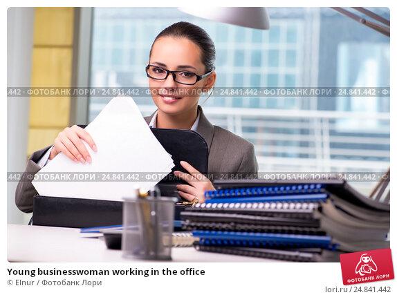 Купить «Young businesswoman working in the office», фото № 24841442, снято 26 сентября 2016 г. (c) Elnur / Фотобанк Лори