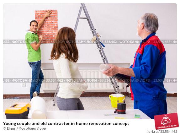 Купить «Young couple and old contractor in home renovation concept», фото № 33534462, снято 2 сентября 2019 г. (c) Elnur / Фотобанк Лори