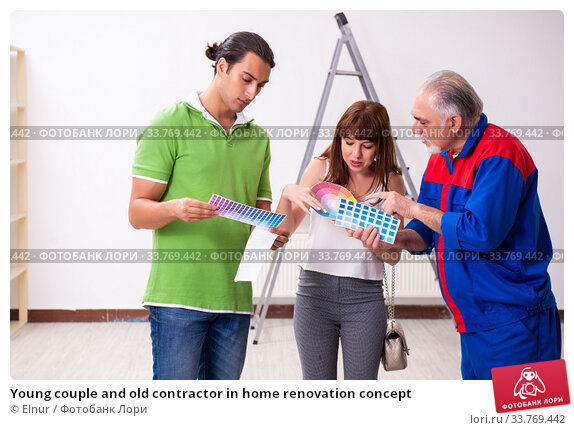 Купить «Young couple and old contractor in home renovation concept», фото № 33769442, снято 2 сентября 2019 г. (c) Elnur / Фотобанк Лори