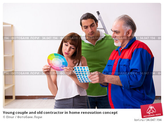 Young couple and old contractor in home renovation concept. Стоковое фото, фотограф Elnur / Фотобанк Лори