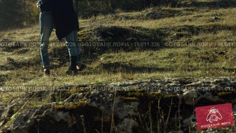 Купить «Young couple in love outdoors in the woods», видеоролик № 31011226, снято 4 августа 2020 г. (c) Denis Mishchenko / Фотобанк Лори