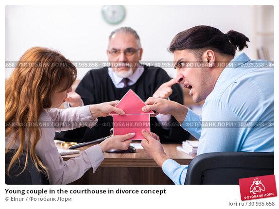 Купить «Young couple in the courthouse in divorce concept», фото № 30935658, снято 28 марта 2019 г. (c) Elnur / Фотобанк Лори
