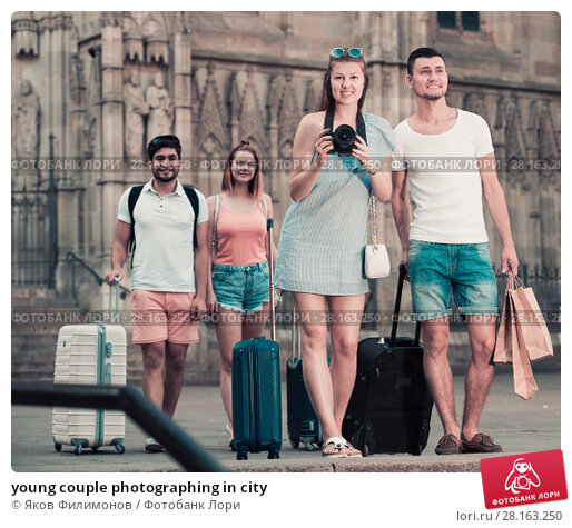 Купить «young couple photographing in city», фото № 28163250, снято 22 июня 2017 г. (c) Яков Филимонов / Фотобанк Лори