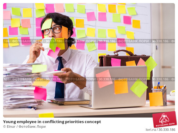Купить «Young employee in conflicting priorities concept», фото № 30330186, снято 16 октября 2018 г. (c) Elnur / Фотобанк Лори