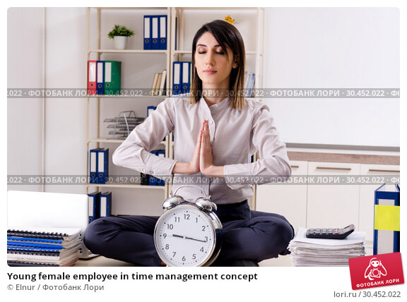 Young female employee in time management concept. Стоковое фото, фотограф Elnur / Фотобанк Лори