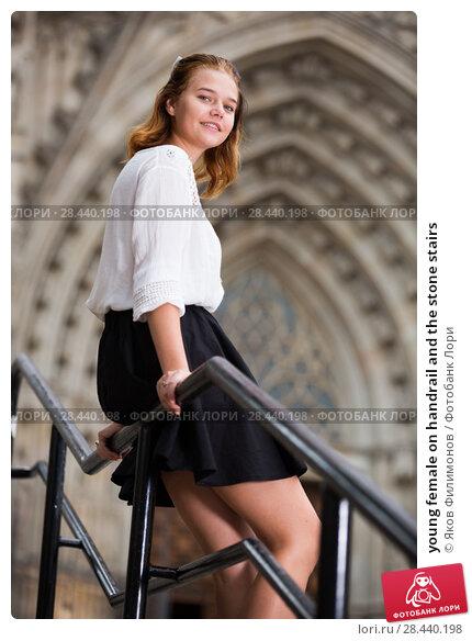Купить «young female on handrail and the stone stairs», фото № 28440198, снято 26 апреля 2019 г. (c) Яков Филимонов / Фотобанк Лори