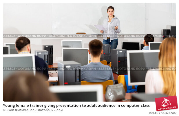 Купить «Young female trainer giving presentation to adult audience in computer class», фото № 33374502, снято 25 мая 2020 г. (c) Яков Филимонов / Фотобанк Лори