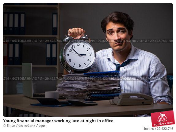 Купить «Young financial manager working late at night in office», фото № 29422746, снято 25 июля 2018 г. (c) Elnur / Фотобанк Лори