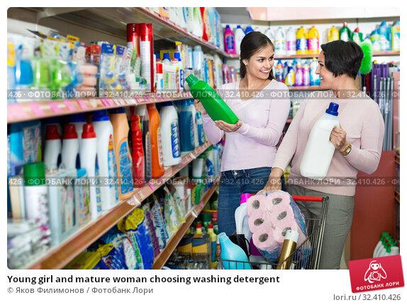 Купить «Young girl and mature woman choosing washing detergent», фото № 32410426, снято 4 декабря 2019 г. (c) Яков Филимонов / Фотобанк Лори