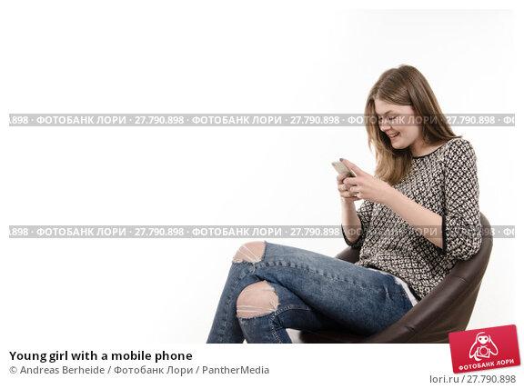 Купить «Young girl with a mobile phone», фото № 27790898, снято 22 октября 2018 г. (c) PantherMedia / Фотобанк Лори