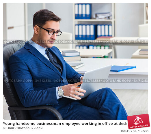 Young handsome businessman employee working in office at desk. Стоковое фото, фотограф Elnur / Фотобанк Лори