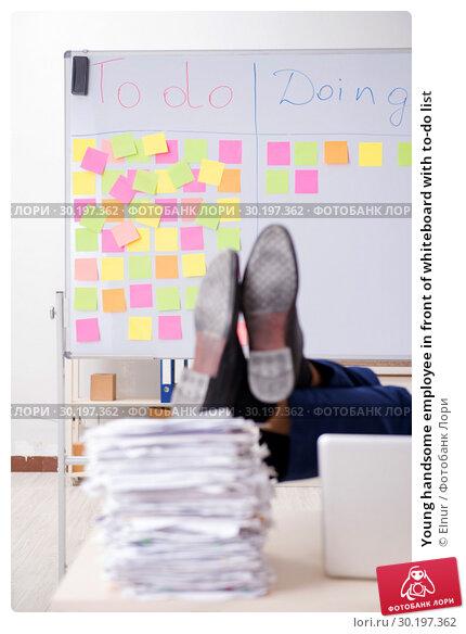 Купить «Young handsome employee in front of whiteboard with to-do list», фото № 30197362, снято 16 октября 2018 г. (c) Elnur / Фотобанк Лори